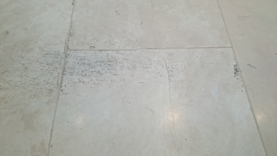 Marks to the incorrect seal on a travertine tiled floor