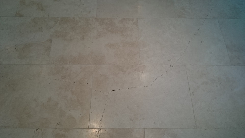 Numerous cracks in a Travertine Floor